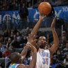 Oklahoma City\'s Kevin Durant (35) shoots the ball over New Orleans\' Quincy Pondexter (20) during the NBA basketball game between the Oklahoma City Thunder and the New Orleans Hornets, Wednesday, Feb. 2, 2011 at the Oklahoma City Arena. Photo by Bryan Terry, The Oklahoman