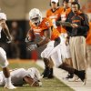 Cowboy Keith Toston goes out of bounds at the end of a run during the college football game between the Oklahoma State University Cowboys (OSU) and the University of Texas Longhorns (UT) at Boone Pickens Stadium in Stillwater, Okla., Saturday, Oct. 31, 2009. Photo by Doug Hoke, The Oklahoman