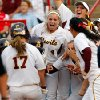 Arizona State celebrates after a home run by Katelyn Boyd (17) in the fifth inning during a Women\'s College World Series softball game between the University of Oklahoma and Arizona State University at ASA Hall of Fame Stadium in Oklahoma City, Thursday, June 2, 2011. ASU won, 3-1. Photo by Nate Billings, The Oklahoman