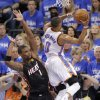 Oklahoma City\'s Russell Westbrook (0) drives past Miami\'s Chris Bosh (1) during Game 2 of the NBA Finals between the Oklahoma City Thunder and the Miami Heat at Chesapeake Energy Arena in Oklahoma City, Thursday, June 14, 2012. Photo by Chris Landsberger, The Oklahoman