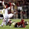 Oklahoma\'s Tom Wort (21) is flipped beside Florida\'s EJ Manuel (3) after an interception during a college football game between the University of Oklahoma (OU) and Florida State (FSU) at Doak Campbell Stadium in Tallahassee, Fla., Saturday, Sept. 17, 2011. Photo by Bryan Terry, The Oklahoman
