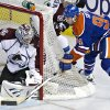 Photo - Colorado Avalanche goalie Semyon Varlamov makes the save on Edmonton Oilers' Ryan Smyth during the second period of an NHL hockey game in Edmonton, Alberta, Saturday, Feb. 16, 2013. (AP Photo/The Canadian Press, Jason Franson)