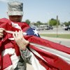 Photo - U.S. / UNITED STATES / AMERICA / AMERICAN / FLAG: Master Sgt. Jason Noreen holds the flag as it lowered, Thursday, June 4, 2009, at Tinker Air Force Base in Midwest City, Okla. Photo by Sarah Phipps, The Oklahoman ORG XMIT: KOD