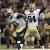 Photo - New Orleans Saints linebacker Junior Galette (93) and defensive end Cameron Jordan (94) celebrate a sack in the second half of an NFL football game against the Atlanta Falcons in New Orleans, Sunday, Sept. 8, 2013. (AP Photo/Bill Feig)
