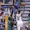 Photo - Utah Jazz's Marvin Williams (2) shoots as Boston Celtics' Gerald Wallace (45) defends in the second quarter of an NBA basketball game, Monday, Feb. 24, 2014, in Salt Lake City. (AP Photo/Rick Bowmer)