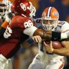 Oklahoma's Adrian Taylor, left, hits Florida's Tim Tebow at the line of scrimmage during the first half of BCS Championship on Jan. 8, 2009. Tebow and the Gators scored only 24 points in their victory over the Sooners, which was far below their scoring average for the season. PHOTO BY BRYAN TERRY, THE OKLAHOMAN Archives