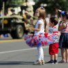 From left, Lilyannah Powers, 4, Daemon Riley, 2, and Aiyana Riley, 4, watch the Edmond LibertyFest Parade in downtown Edmond, Okla., on Independence Day, Friday, July 4, 2014. Photo by Nate Billings, The Oklahoman