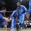 Oklahoma City\'s Kevin Durant is greeted by teammates, including Nick Collison, left, as Durant is introduced before the NBA basketball game between the Washington Wizards and the Oklahoma City Thunder at the Oklahoma City Arena in Oklahoma City, Friday, January 28, 2011. The Thunder won, 124-117, in double overtime. Photo by Nate Billings, The Oklahoman