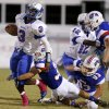 Millwood\'s Cameron Montgomery tries to get past Christian Heritage Academy\'s Jacob Files during their high school football game at Christian Heritage in Oklahoma City, Friday, Oct. 4, 2013. Photo by Bryan Terry, The Oklahoman