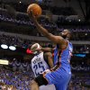 Oklahoma City\'s James Harden (13) tries to get past Dallas\' Vince Carter (25) during Game 4 of the first round in the NBA playoffs between the Oklahoma City Thunder and the Dallas Mavericks at American Airlines Center in Dallas, Saturday, May 5, 2012. Photo by Bryan Terry, The Oklahoman