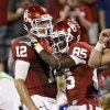 Oklahoma\'s Landry Jones (12) and Ryan Broyles (85) celebrate after a touchdown during the college football game between the University of Oklahoma Sooners ( OU) and the Tulsa University Hurricanes (TU) at the Gaylord Family-Memorial Stadium on Saturday, Sept. 3, 2011, in Norman, Okla. Oklahoma won 47-14. Photo by Bryan Terry, The Oklahoman ORG XMIT: KOD