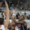 United States Kevin Durant, right, shoots over Spain\'s Rudy Fernandez during the Americans\' 86-85 win in Madrid on Sunday. AP PHOTO
