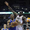 Golden State Warriors\' Jarrett Jack, front left, drives to the basket around Milwaukee Bucks\' Ekpe Udoh during the first half of an NBA basketball game on Saturday, Jan. 26, 2013, in Milwaukee. (AP Photo/Jim Prisching)