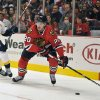 Nashville Predators\' Roman Josi (59) defends as the Chicago Blackhawks\' Brandon Saad (20) looks to pass during the second period of an NHL hockey game on Friday, April 19, 2013, in Chicago. (AP Photo/Jim Prisching)