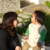 "In this photo released by Minako Kubota, Kubota chats with her two-year-old son in Naha, Okinawa, Japan. Okinawa is about as far away as one can get from Fukushima without leaving Japan, and that is why Kubota is here. Petrified of the radiation spewing from the Fukushima Dai-ichi nuclear plant that went into multiple meltdowns last year, Kubota grabbed her children, left her skeptical husband and moved to the small southwestern island. More than a thousand people from the disaster zone have done the same thing. ""I thought I would lose my mind,"" Kubota told The Associated Press in a recent interview. ""I felt I would have no answer for my children if, after they grew up, they ever asked me,"