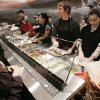 Melissa Perry watches her free burrito being made at Chipotle Mexican Grill in Edmond, Ok. WEd. Jan. 16, 2008. BY JACONNA AGUIRRE/THE OKLAHOMAN