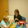 Whitney Grigsby, a doctoral student in occupational therapy from Creighton University, is working with J. D. McCarty Center patient Dalton Blevens. Disguised as play, Grigsby is helping Blevens work on his fine motor and visual skills as well as his bilateral coordination while creating spin paint artwork. Blevens was just one of the patients that Grigsby worked with during her 12-week pediatric clinical rotation at the J. D. McCarty Center in Norman, Oklahoma. The McCarty Center is a pediatric rehab specialty hospital that specializes in children with developmental disabilities. Community Photo By: Greg Gaston Submitted By: Greg,