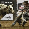 Bullfighter Eric Layton of Red Bluff, Cali., helps Allen Helmuth of Eugene, Oreg., get away from Thunder Struck during the National Circuit Finals Rodeo at State Fair Arena in Oklahoma City, Thursday, March 29, 2012. Photo by Bryan Terry, The Oklahoman