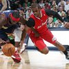 Photo - Denver Nuggets guard Ty Lawson, left, pursues a loose ball with Los Angeles Clippers guard Chris Paul in the first quarter of an NBA basketball game in Denver on Monday, March 17, 2014. (AP Photo/David Zalubowski)