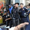 Photo -   A person associated with the Occupy movement is arrested on a march down Broadway Street in New York enroute to Zuccotti Park, Saturday, Sept. 15, 2012. Monday marks the one year anniversary of the Occupy movement. (AP Photo/Stephanie Keith)
