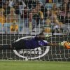 Photo - South Africa's Senzo Robert Meyiwa makes a diving save against Australia during their friendly soccer match in Sydney, Monday, May 26, 2014. (AP Photo/Rick Rycroft)