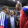The Rev. Jesse Jackson, center, talks to Los Angeles Clippers\' Chris Paul and Jamal Crawford before Game 5 of the Clippers\' opening-round NBA basketball playoff series against the Golden State Warriors on Tuesday, April 29, 2014, in Los Angeles. NBA Commissioner Adam Silver announced Tuesday that Clippers owner Donald Sterling has been banned for life by the league. (AP Photo/Ringo H.W. Chiu)
