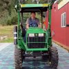 Photo - In this May 2014, photo provided by Solar Roadways, Scott Brusaw drives a tractor on a prototype solar-panel parking area at his company's business in Sandpoint, Idaho. Brusaw's idea for solar-powered roads has gone viral and raised more than $1.4 million in crowdsourced funding. Brusaw is proposing to pave driveways, parking lots, bike trails and, eventually, highways with hexagon-shaped solar panels that will produce electricity and could even propel electric cars. (AP Photo/Solar Roadways)