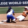 Florida third baseman Stephanie Tofft tags out Texas runner Torie Schmidt in the Women\'s College World Series elimination game versus Texas. The Longhorns would go on to win 3-0. Photo by KT KING, The Oklahoman