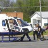 Medics load a woman onto a helicopter for transport after she was injured in shooting Saturday, April 10, 2010, at Arrowhead Mall in Muskogee, Oklahoma. Gunfire broke out inside a crowded downtown Muskogee shopping mall on Saturday, in what witnesses described as a gunfight, police said. (AP Photo/The Daily Phoenix, Jerry Willis)