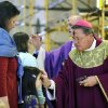 The Most Rev. Michael Cote, Bishop of the Catholic Diocese of Norwich, Conn., right, imposes ashes in the shape of the cross on the forehead of Keara Opalenik, 5, as her mother Holly, left, awaits her turn during the noon Ash Wednesday Mass at the Cathedral of St. Patrick in Norwich, Conn. Wednesday, Feb. 22, 2012. Ash Wednesday marks the beginning of Lent in the Christian calendar. (AP Photo/The Day, Sean D. Elliot) MANDATORY CREDIT