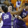 TCU\'s Latricia Lovings (21) grabs a rebound beside Oklahoma State\'s Lindsey Keller (25) during a women\'s college basketball game between Oklahoma State University and TCU at Gallagher-Iba Arena in Stillwater, Okla., Tuesday, Feb. 5, 2013. Oklahoma State won 76-59. Photo by Bryan Terry, The Oklahoman