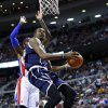 Photo - Oklahoma City Thunder forward Kevin Durant (35) drives against Detroit Pistons forward Josh Smith (6) in the first half of an NBA basketball game in Detroit, Friday, Nov. 8, 2013. (AP Photo/Paul Sancya)