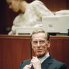 Photo - FILE - In this Thursday, Nov. 14, 1991, file photo, Charles Keating Jr., adjusts his tie as he sits in a Los Angeles courtroom. Keating, the financier who was disgraced for his role in the costliest savings and loan failure of the 1980s, has died. He was 90. A person with direct knowledge of the death confirmed that Keating died but didn't provide further details. The person wasn't authorized to release the information and spoke on condition of anonymity. (AP Photo/Nick Ut)