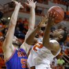 Oklahoma State\'s Markel Brown (22) goes to the basket beside Texas-Arlington\'s Jordan Reves (55) during a college basketball game between Oklahoma State University and UT Arlington at Gallagher-Iba Arena in Stillwater, Okla., Wednesday, Dec. 19, 2012. Photo by Bryan Terry, The Oklahoman