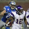 Minnesota Vikings\' Percy Harvin (12) returns the opening kick for a touchdown during the first quarter of an NFL football game against the Detroit Lions at Ford Field in Detroit, Sunday, Sept. 30, 2012. (AP Photo/Carlos Osorio)
