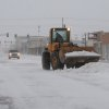 Photo - City crews remove snow early Monday, Feb. 25, 2013 in Liberal, Kan., which is under a blizzard warning until Tuesday midnight. WInds were around 25 to 30 mph by 9 a.m., with forecasts of higher winds and gusts to 5o mph in the afternoon. (AP Photo/Southwest Daily Times, Larry Phillips)