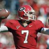 Photo - Georgia quarterback Matthew Stafford looks for a receiver during the Bulldogs' game against Mississippi State Saturday, Oct. 21, 2006, in Athens, Ga. (AP Photo/Todd Bennett) ORG XMIT: AX103