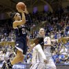 Photo - Notre Dame's Kayla McBride (21) drives to the basket as Duke's Alexis Jones and Haley Peters, right, defend during the second half of an NCAA college basketball game in Durham, N.C., Sunday, Feb. 2, 2014. Notre Dame won 88-67. (AP Photo/Gerry Broome)