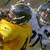 Pittsburgh Steelers tight end David Paulson, right, tries to block linebacker Alan Baxter in a one-on-one drill in practice during an NFL football training camp at the team\'s training facility in Latrobe, Pa., on Monday, July 29, 2013. (AP Photo/Keith Srakocic)