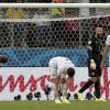 USA players react after Belgium\'s Romelu Lukaku scored his side\'s second goal in extra time during the World Cup round of 16 soccer match between Belgium and the USA at the Arena Fonte Nova in Salvador, Brazil, Tuesday, July 1, 2014. (AP Photo/Marcio Jose Sanchez)