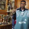 Photo - FILE - In this Friday, April 4, 2008 file photo, Palestinian athlete Nader Masri, 28, holds the shirt he will be wearing when competing in the 2008 Olympics, at his home in Beit Hanoun, northern Gaza Strip. On Tuesday, April 8, 2014 Israel's high court has upheld a decision by the military to prevent Nader Masri, 34, a Gaza Olympian, from leaving the coastal strip to participate in a marathon in the West Bank. Israel has severely restricted the movement of people and goods in and out of Gaza since the Islamic militant Hamas took control there in 2007. Tuesday's ruling ends hopes of 34-year-old Nader Masri to participate in Friday's marathon in biblical Bethlehem. Israel says only humanitarian hardship cases are allowed to leave Gaza. (AP Photo/Majed Hamdan)