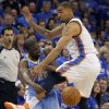Oklahoma City\'s Thabo Sefolosha (2) defends on Denver\'s Raymond Felton (20) during the first round NBA playoff game between the Oklahoma City Thunder and the Denver Nuggets on Sunday, April 17, 2011, in Oklahoma City, Okla. Photo by Chris Landsberger, The Oklahoman