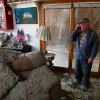 Blaine Lawson, 76, stands inside his house after a reported tornado tore the roof off his home, Friday, March 2, 2012, in Cleveland, Tenn. Neither he nor his wife were injured. (AP Photo/Robert Ray) ORG XMIT: TNRR101