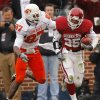 Oklahoma\'s D.J. Wolfe (25) takes a fumble recovery up filed past Oklahoma State\'s Brandon Pettigrew (87) during the first half of the college football game between the University of Oklahoma Sooners (OU) and the Oklahoma State University Cowboys (OSU) at the Gaylord Family-Memorial Stadium on Saturday, Nov. 24, 2007, in Norman, Okla. Photo By CHRIS LANDSBERGER, The Oklahoman