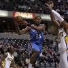 Photo - Oklahoma City Thunder guard Earl Watson, center, makes a pass around Indiana Pacers forward Danny Granger, right, after getting past Pacers guard Marquis Daniels in the first half of an NBA basketball game in Indianapolis, Monday, Nov. 10, 2008. (AP Photo/Michael Conroy) ORG XMIT: NAF101