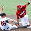 Photo - Louisiana-Lafayette's Seth Harrison (27) slides to first base past San Diego State first baseman Ryan Muno (16) during an NCAA college baseball tournament regional game in Lafayette, La., Saturday, May 31, 2014. Louisiana-Lafayette won 9-2. (AP Photo/Jonathan Bachman)