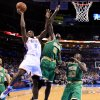 Oklahoma City\'s Serge Ibaka (9) shoots a lay up as Boston\'s Kevin Garnett (5) and Boston\'s Brandon Bass (30) defend during the NBA game between the Oklahoma City Thunder and the Boston Celtics at the Chesapeake Energy Arena in Oklahoma City, Sunday, March 10, 2013. Photo by Sarah Phipps, The Oklahoman