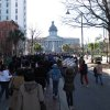 Photo - Several hundred marchers approach the South Carolina Statehouse for the NAACP's annual  Martin Luther King Day rally in Columbia, S.C. on Monday, Jan. 21, 2013. The focus of the annual rally this year was on mental health. (AP Photo/Jeffrey Collins)