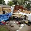 A garage smashed in Friday's tornado is pushed up against a house at Kansas Street and Pickard Avenue.