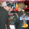 Driver sTony Stewart, left, and Mark Martin talk in the garage during practice for Sunday\'s NASCAR Sprint Cup Series auto race at New Hampshire Motor Speedway, Saturday, Sept. 21, 2013, in Loudon, N.H. (AP Photo/Jim Cole)